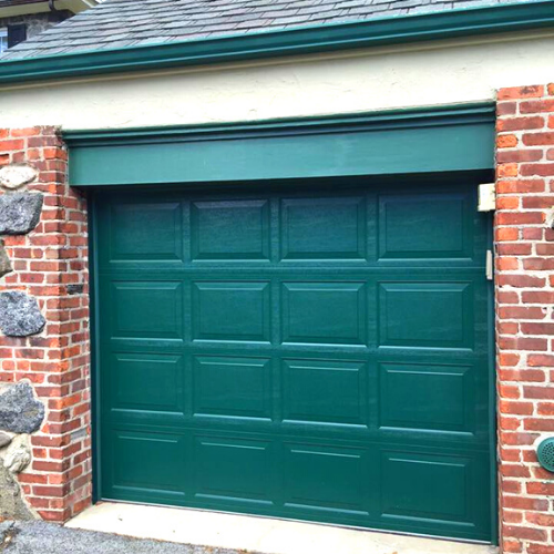 Green residential garage door after annual garage door maintenance