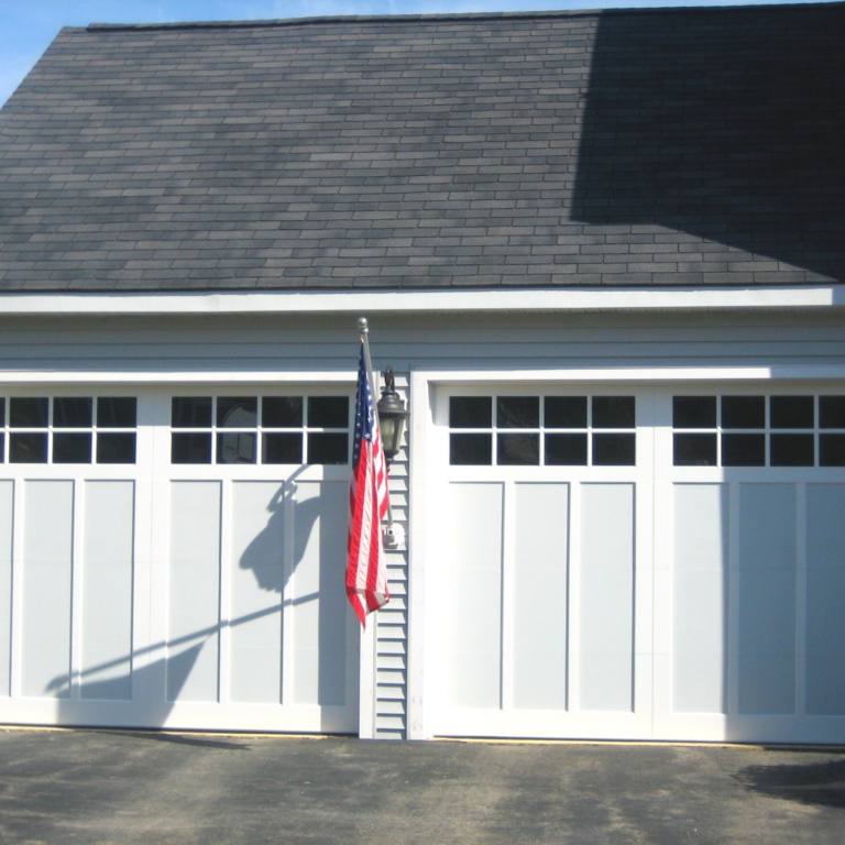 two white residential garage doors